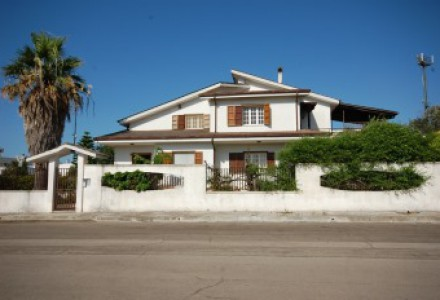 Three-storey detached villa with private garden.